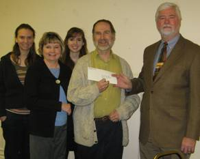 Reid presents check for hymnals